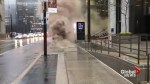 Smoke billows from sewer grate in downtown Toronto